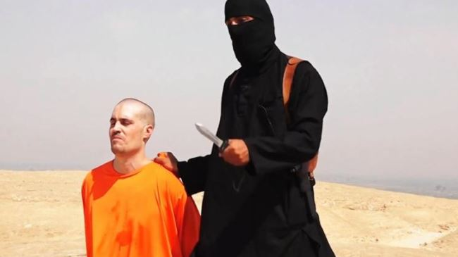 This video grab shows an ISIL agent preparing to behead American journalist James Foley.