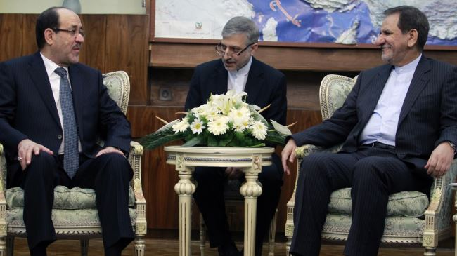 Eshagh Jahangiri at a meeting with Nouri al-Maliki