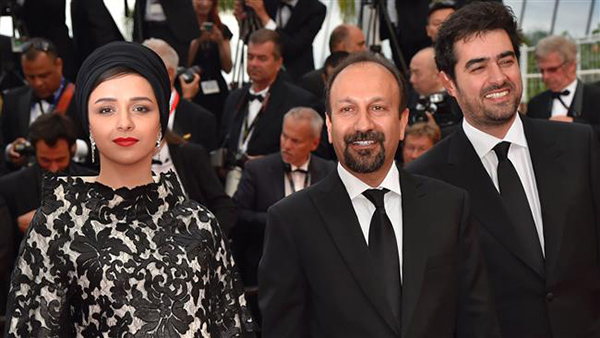 (From L) actress Taraneh Alidousti, director Asghar Farhadi and actor Shahab Hosseini pose as they arrive for the closing ceremony.