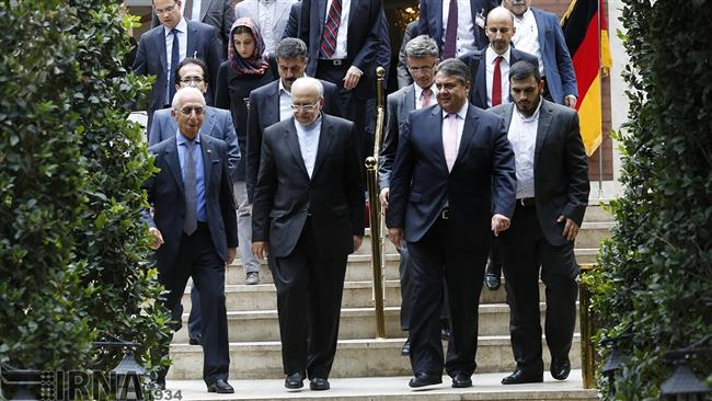 Iran's Industry Minister Mohammad Reza Nematzadeh (2nd L) and German Economy Minister Sigmar Gabriel (2nd R) are leaving a meeting after talks in Tehran.