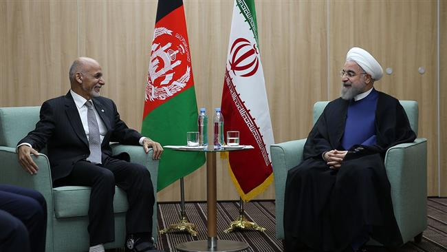 Iranian President Hassan Rouhani (R) meets with his Afghan counterpart Mohammad Ashraf Ghani on the sidelines of the 7th BRICS summit in Ufa on July 9, 2015.
