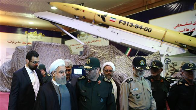 Iran's Defense Minister Brigadier General Hossein Dehqan (3rd L) speaks to President Hassan Rouhani during a ceremony on August 22, 2015 to unveil a new solid-fuel precision-guided missile, named Fateh 313. © president.ir
