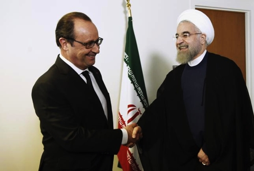French President Francois Hollande welcomes his Iranian counterpart Hassan Rouhani for a meeting during the 70th UN General Assembly in New York City