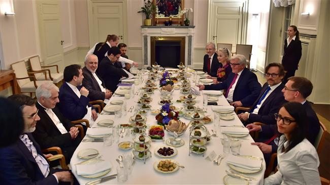 German Foreign Minister Frank-Walter Steinmeier (4th, R), Iranian Foreign Minister Mohammad Javad Zarif (4th, L), and their delegations attend a working iftar meal at Villa Borsig, the guesthouse of the German Foreign Ministry in the suburbs of Berlin on June 15, 2016. (AFP)