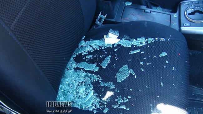 Broken glass is seen on the seat of the vehicle carrying Iranian MP that came under a terrorist attack in the western province of Kermanshah. (IRIB photo)