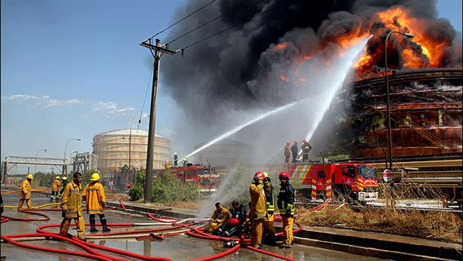 Iranian firefighters are seen fighting a raging fire at Bu Ali Sina Petrochemical Complex in the country's southwestern province of Khuzestan on July 8, 2016. ©SHANA