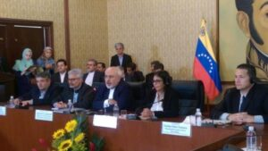 Iranian Foreign Minister Mohammad Javad Zarif (C) attends the Iran-Venezuela economic and trade summit in Caracas on August 27, 2016, with his Venezuelan counterpart, Delcy Rodriguez (2nd right), in attendance.