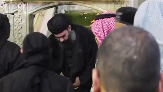 A photo released by Iraq's al-Sumaria TV shows Daesh ringleader Ibrahim al-Samarrai aka Abu Bakr al-Baghdadi in a Mosul neighborhood.