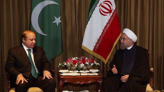 Iranian President Hassan Rouhani (R) meets with Pakistan's Prime Minister Nawaz Sharif in New York on September 21, 2016.