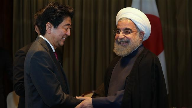Iranian President Hassan Rouhani (R) meets with Japanese Prime Minister Shinzo Abe New York on September 21, 2016.