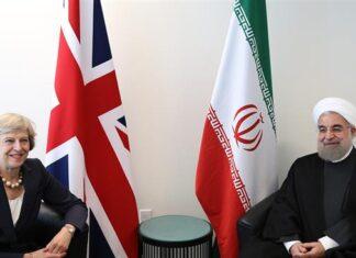 Rouhani Theresa May
