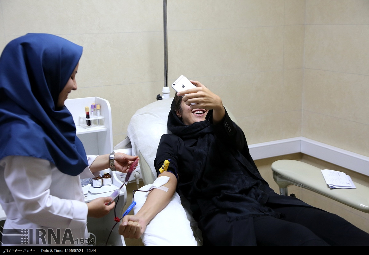 Iranian woman donating her blood as a religious vow in Muharram