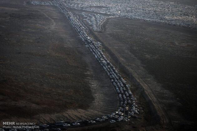 pilgrims' cars parked near border crossing