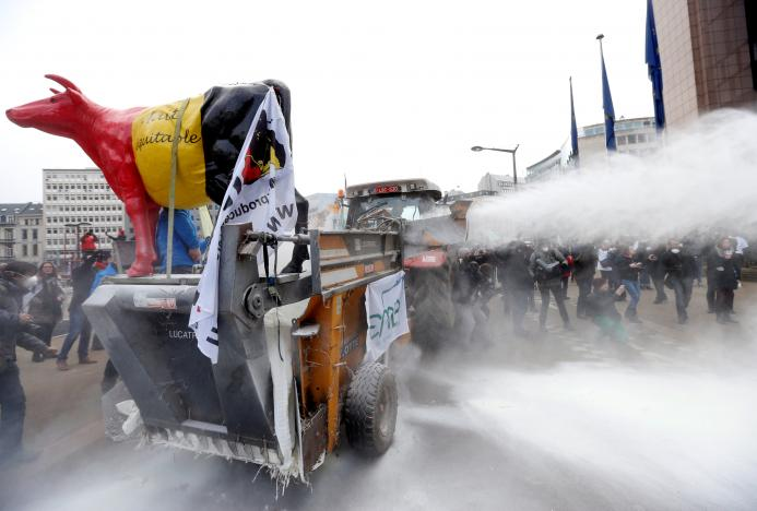 Milk producers spray powdered milk to protest against dairy market overcapacity in Brussels