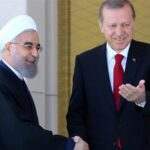 Iranian President Hassan Rouhani (L) and his Turkish counterpart Recep Tayyip Erdogan shake hands during an official welcoming ceremony at the presidential complex in Ankara, Turkey, on April 16, 2016. (Photo by AFP)