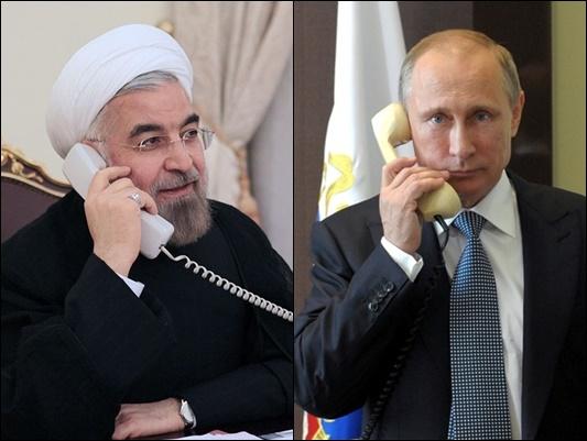 بوتين وروحاني يبحثان هاتفیا الاتفاق النووي والتعاون الاقليمي