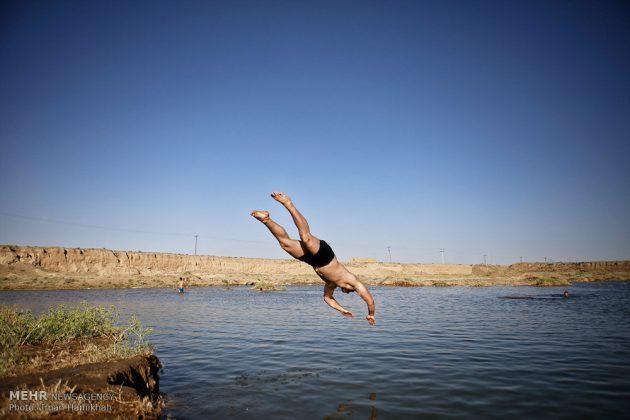 برك الماء ملاذ شباب همدان الايرانية في الصيف18