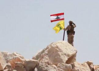 Hezbollah Takes Down ISIS Flag on Syrian Border