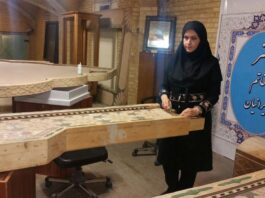 """The Iranian inlaying craftswoman, Maliheh Fakhreddin, in a Farsi interview with IRNA has talked about the characteristics of the world's largest Khatam frame, which is under construction at the moment. """"The frame is 7 by 8.4 metres, weighing more than 2 tonnes, and will be introduced to be registered in the Guinness Book of Records after the completion,"""" she added. According to Fakhreddin, the knitting process of this frame has been completed, and it will be ornamented with marquetry, wood-carving and turquoise-laying as well. """"I believe that Khatam is the end of all arts, and the creativity and elegance of this art is not comparable to any other one,"""" she went on to say. This artisan also emphasized that although art of crafting Khatam is common in countries like India, the Khatam made in the Iranian south-central city of Shiraz is very high-quality and incomparable to foreign and even domestic samples. """"The difference between Shiraz's Khatam and other domestic Khatams is that camel or cow bones and bronze are used in it while in other types plastic fibres are used instead of bone, and bronze metal is rarely used. Moreover, they use liquid adhesive instead of wood glue."""" The Iranian craftswoman added that the theme of this frame is to pay homage to the four greatest women of the world, i.e. (Hazrat Fatima Zahra (SA) (daughter of Prophet Muhammad), Saint Mary (mother of Jesus), Hazrat Asiyah (wife of the Pharaoh) and Hazrat Khadijeh (SA) (wife of Prophet Muhammad). """"In this project, whose idea was set forth by Hadi Chabok, we tried to put Hazrat Fatima Zahra (SA) at the centre of the frame, and the name of three other great women are placed inside this central frame,"""" she noted. """"We've done our best to create an international work having elements from different religions. Therefore, there are lines and texts in the form of scriptures of the holy Quran, Gospels and the Torah. The texts are in Persian, Arabic, English and Hebrew and they are placed on frames by art of"""