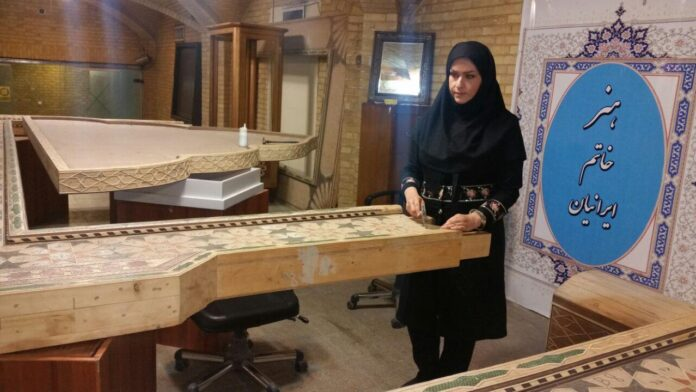 "The Iranian inlaying craftswoman, Maliheh Fakhreddin, in a Farsi interview with IRNA has talked about the characteristics of the world's largest Khatam frame, which is under construction at the moment. ""The frame is 7 by 8.4 metres, weighing more than 2 tonnes, and will be introduced to be registered in the Guinness Book of Records after the completion,"" she added. According to Fakhreddin, the knitting process of this frame has been completed, and it will be ornamented with marquetry, wood-carving and turquoise-laying as well. ""I believe that Khatam is the end of all arts, and the creativity and elegance of this art is not comparable to any other one,"" she went on to say. This artisan also emphasized that although art of crafting Khatam is common in countries like India, the Khatam made in the Iranian south-central city of Shiraz is very high-quality and incomparable to foreign and even domestic samples. ""The difference between Shiraz's Khatam and other domestic Khatams is that camel or cow bones and bronze are used in it while in other types plastic fibres are used instead of bone, and bronze metal is rarely used. Moreover, they use liquid adhesive instead of wood glue."" The Iranian craftswoman added that the theme of this frame is to pay homage to the four greatest women of the world, i.e. (Hazrat Fatima Zahra (SA) (daughter of Prophet Muhammad), Saint Mary (mother of Jesus), Hazrat Asiyah (wife of the Pharaoh) and Hazrat Khadijeh (SA) (wife of Prophet Muhammad). ""In this project, whose idea was set forth by Hadi Chabok, we tried to put Hazrat Fatima Zahra (SA) at the centre of the frame, and the name of three other great women are placed inside this central frame,"" she noted. ""We've done our best to create an international work having elements from different religions. Therefore, there are lines and texts in the form of scriptures of the holy Quran, Gospels and the Torah. The texts are in Persian, Arabic, English and Hebrew and they are placed on frames by art of marquetry."" Fakhreddin also pointed out that the work on this Khatam frame began in 2016 and it would be completed by the summer of 2018."