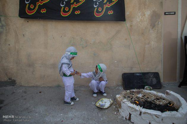 """مراسم """"التلطخ بالطين"""" يوم عاشوراء في لرستان الايرانية16"""