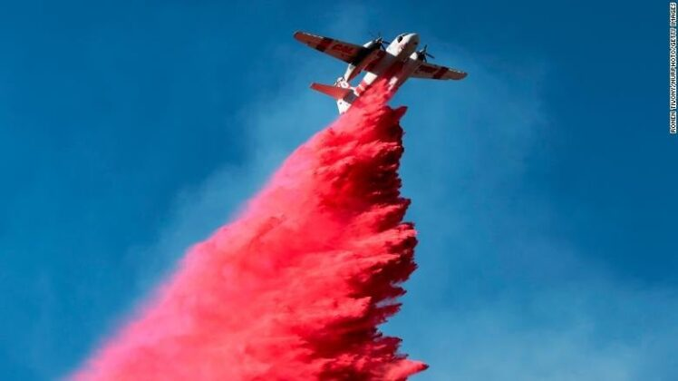 A plane drops fire retardant on the Woolsey Fire near Malibu on Nov. 12 / Photo by Getty Images