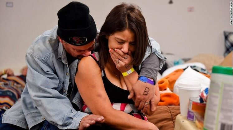 A couple embracing at a shelter in Chico on Nov. 12 after their home was devasted by Camp Fire / Photo by AP