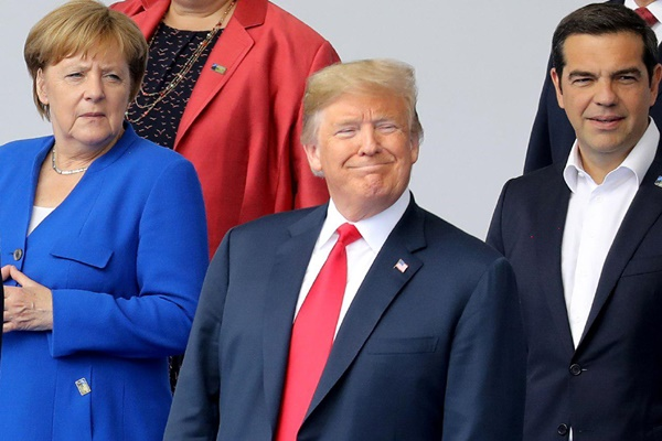 US President Donald Trump meets with German Chancellor Angela Merkel during their bilateral meeting at the NATO Summit in Brussels, Belgium, Wednesday, July, 11, 2018. / Photo by AP