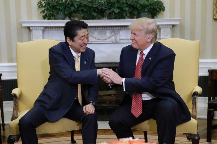 PHOTO: Japanese Prime Minister Shinzo Abe (L) has met with US President Donald Trump in Washington. (AP: Evan Vucci)