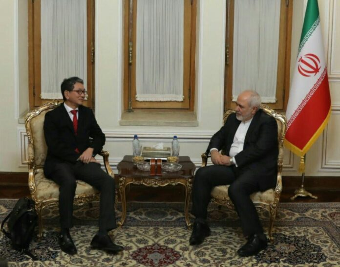 Mohammad Javad Zarif and Japan Senior Deputy Minister for Foreign Affairs Takeo Mori