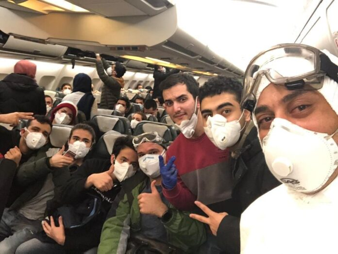 Iranian students pose for a photo during a flight that evacuated them from the Chinese city of Wuhan, the epicentre of the novel coronavirus
