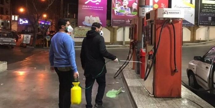 Young Volunteers Disinfect Tehran at Nighttime