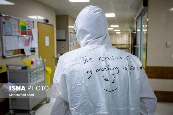 Iranian Medical Staff Wearing Masks Speak via Poems on their Suits 2
