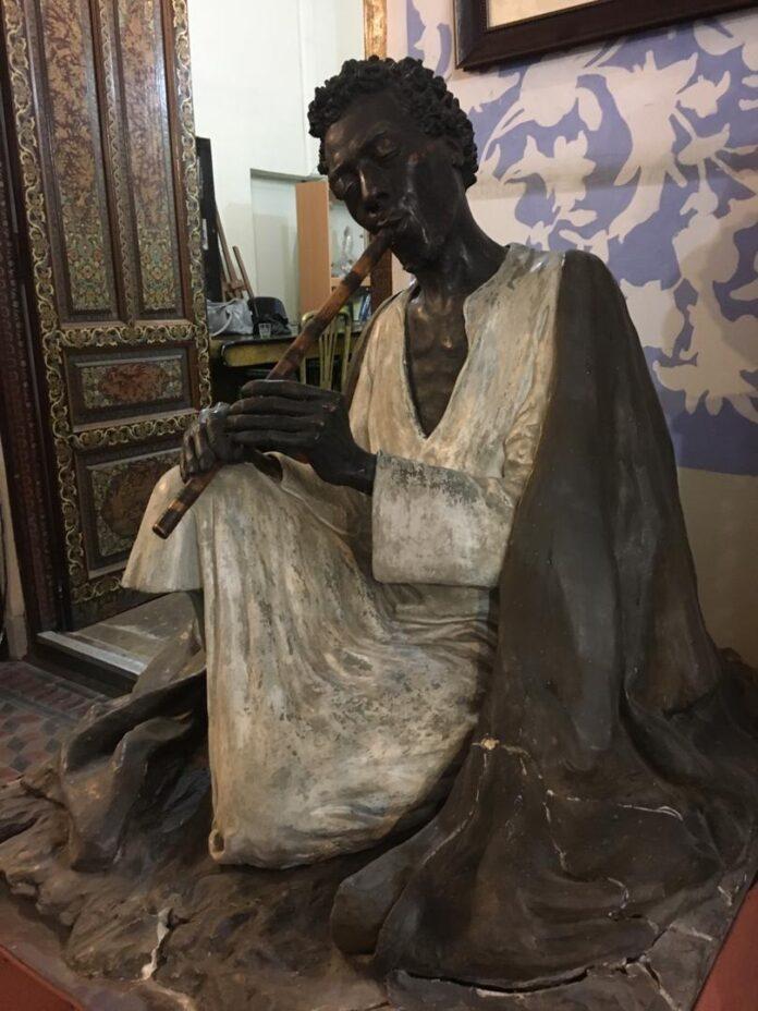 Black Flute Player: Magnificent Sculpture by Master Sadighi